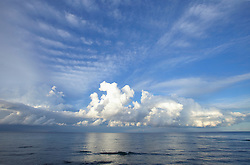Storm thunder clouds ocean sea reflection