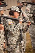 A woman Drill Sergeant candidate prepares her weapon for inspection at the US Army Drill Instructors School Fort Jackson during weapons training September 26, 2013 in Columbia, SC. While 14 percent of the Army is women soldiers there is a shortage of female Drill Sergeants.