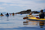 Kayakers, leaving Wildcat Cove in Larrabee State Park, view Gargoyle Rock, which leads to Chuckanut Bay and Chuckanut Island near Bellingham.<br /> <br /> Ken Lambert / The Seattle Times