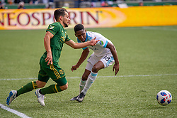 November 4, 2018 - Portland, OR, U.S. - PORTLAND, OR - NOVEMBER 04: Portland Timbers midfielder Sebastián Blanco (10) dribbles past Seattle Sounders defender Kelvin Leerdam during the Portland Timbers first leg of the MLS Western Conference Semifinals against the Seattle Sounders on November 04, 2018, at Providence Park in Portland, OR. (Photo by Diego Diaz/Icon Sportswire) (Credit Image: © Diego Diaz/Icon SMI via ZUMA Press)