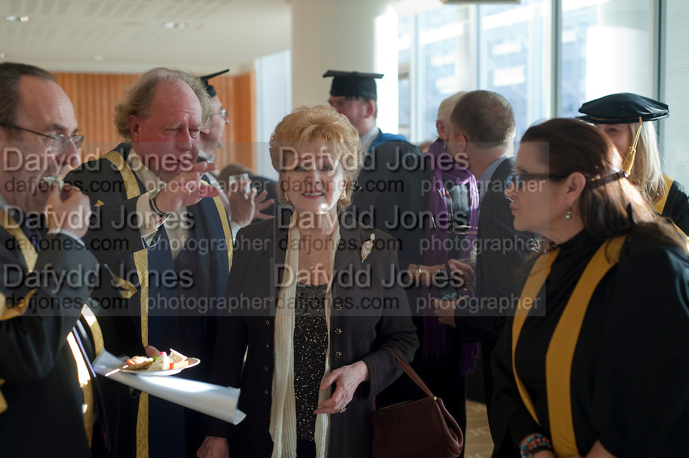 PRINCIPAL GAVIN HENDERSON; DEBBIE REYNOLDS; CARRIE FISHER;  . Central School of Speech and Drama presents Honory Fellowships to Carrie Fisher, Bette Bourne, Joseph Selig and Helen Lannaghan. Royal Festival Hall. London. 12 December 2011.