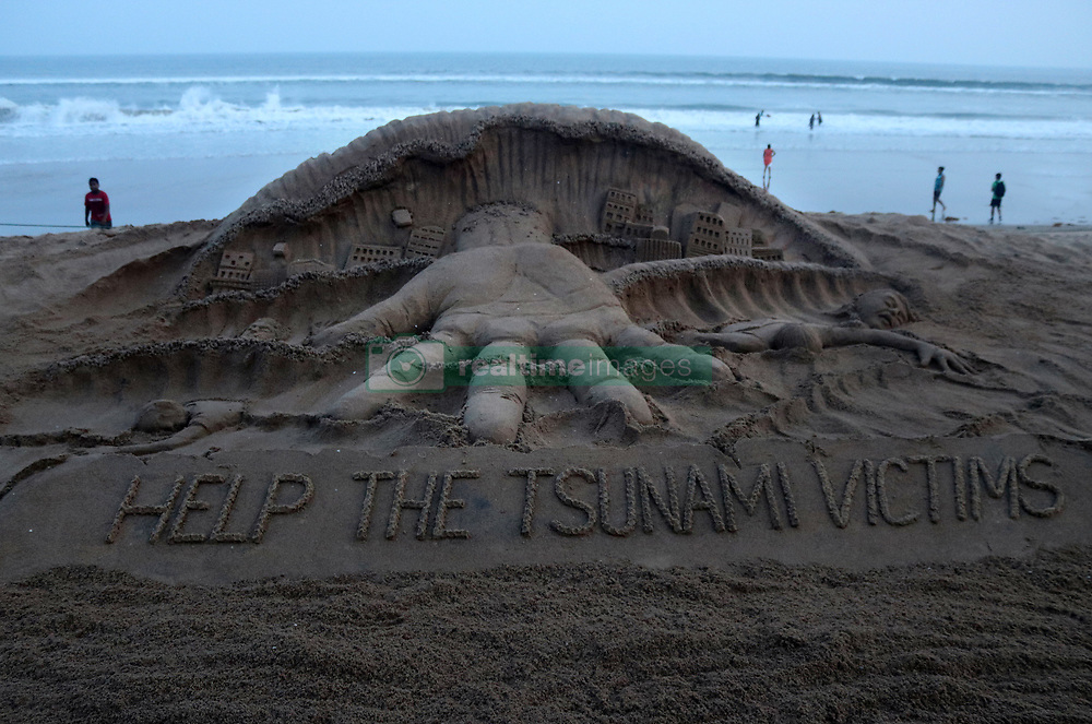 September 30, 2018 - Bhubaneswar, Odisha, India - A sand sculpture is seen at the Bay of Bengal Sea's eastern coast beach at Puri as it is creating by Indian sand artist Sudarshan Pattnaik to spread out the message to help Indonesia Tsunami victims at Puri, 65 km away from the eastern Indian state Odisha's capital city Bhubaneswar on 30 September 2018. (Credit Image: © Str/NurPhoto/ZUMA Press)