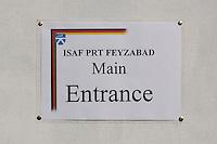 """26 SEP 2004, FEYZABAD/AFGHANISTAN:<br /> Schild """"ISAF PRT FEYZABAD - MAIN ENTRANCE"""" am Haupteingang des Lagers des Provincial Reconstruction Teams des Deutsche Einsatzkontingents ISAF, PRT ISAF, in Feyzabad<br /> IMAGE: 20040926-01-031<br /> KEYWORDS: Sign, Faisabad"""