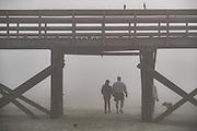 Thick fog blankets Isle of Palms beach a Sea Island near Charleston, South Carolina.