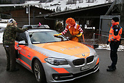 Clowns pretend to clean a police car on the first day of the Strike WEF march on Davos on 18th of January 2020 near Davos, Switzerland. The first day of the march started in Lanquart with speeches and hot food and ended in Schiers.  The protest is planned to finish in Davos with a public meeting in the town on the day the WEF begins. The march is a three day protest against the World Economic Forum meeting in Davos. The activists want climate justice and think that The WEF is for the worlds richest and political elite only.