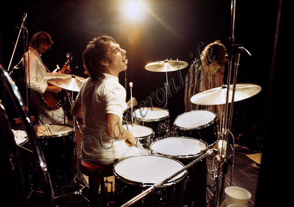 Keith Moon - The Who .- .Pete Townshend looks on as Keith Moon does his stuff. The whole band was on great form and the sound was amazing. The band had supplied their own PA and the excellent quality did them proud. The set was a marathon and has gone down as one of the best sets of the Festival.