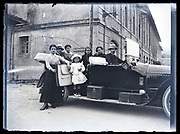 family posing with the new shiny automobile France circa 1920s