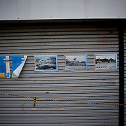 May 25, 2013 - Matsushima, Japan: Posters with images of destruction, can be seen in the doors of a former shop that closed down due to the damaged cause by the 2011's tsunami that struck Japan's coastal line, causing thousands of deaths. (Paulo Nunes dos Santos)