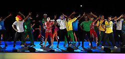 Athletes dance on stage during the Closing Ceremony for the 2018 Commonwealth Games at the Carrara Stadium in the Gold Coast, Australia.