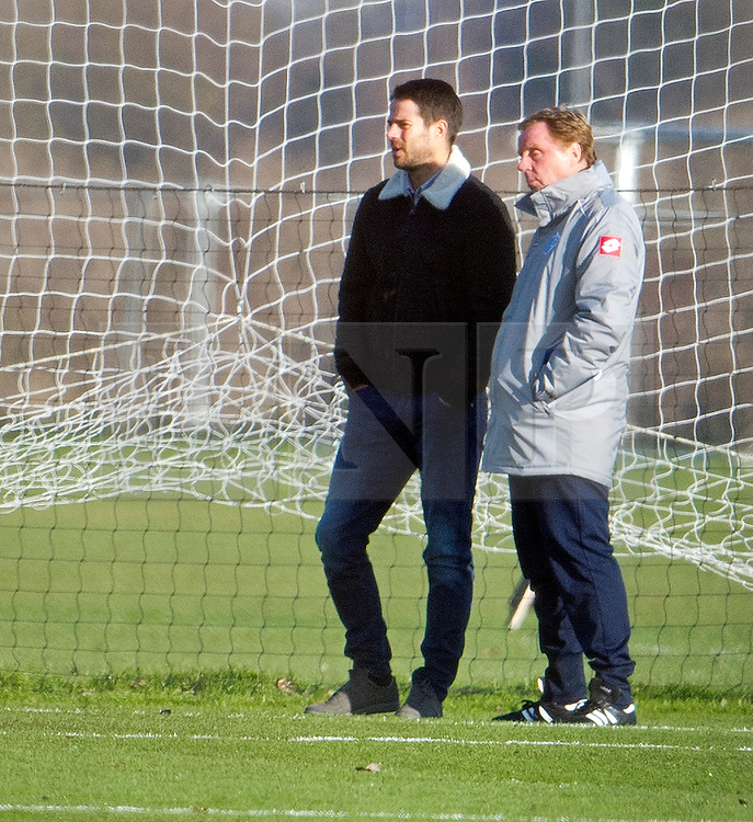 © London News Pictures. 30/11/2012. London, UK. Jamie Redknapp and his father QPR manager Harry Redknapp watch over the QPR squad during training at the QPR training ground in Harlington, Wes London. Photo credit: Ben Cawthra/LNP