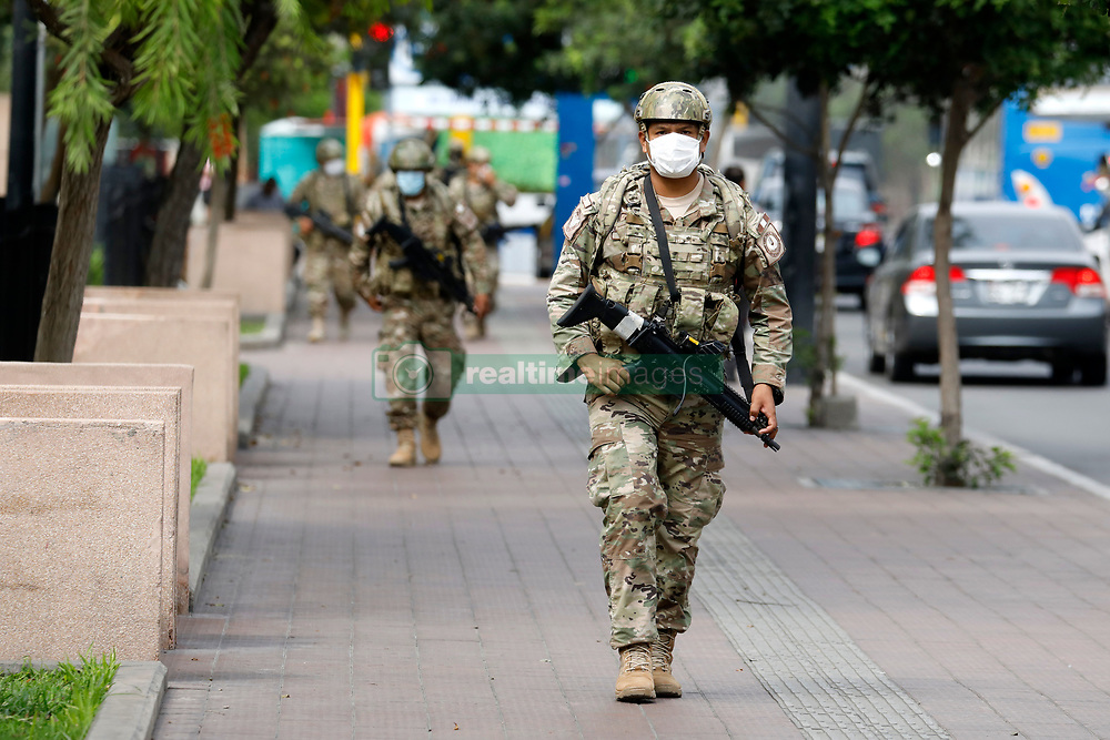 March 16, 2020, Lima, Peru: Peruvian army patrol at  the first day of mandatory quarantine after COVID-19 health alert in Miraflores tourist district of Lima.  Peru close its borders and called on citizens to self-quarantine for 15 days to curb the spread of coronavirus, President Martin Vizcarra announced on March 15. (Credit Image: © Mariana Bazo/ZUMA Wire)