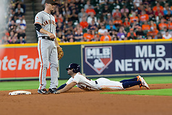 May 23, 2018 - Houston, TX, U.S. - HOUSTON, TX - MAY 23: Houston Astros second baseman Jose Altuve (27) slides into second base without a throw in the fifth inning during MLB baseball game between the Houston Astros and the San Francisco Giants on May 23, 2018 at Minute Maid Park in Houston, Texas. (Photo by Juan DeLeon/Icon Sportswire) (Credit Image: © Juan Deleon/Icon SMI via ZUMA Press)
