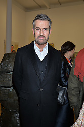 RUPERT EVERETT at the opening private view of 'A Strong Sweet Smell of Incense - A portrait of Robert Fraser, held at the Pace Gallery, Burlington Gardens, London on 5th February 2015.