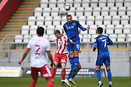 Stevenage forward Luke Norris (36) and Carlisle United defender Rob McDonald (13) challenges for a header during the EFL Sky Bet League 2 match between Stevenage and Carlisle United at the Lamex Stadium, Stevenage, England on 20 March 2021.