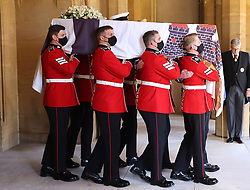 The Duke of Edinburgh's coffin, covered with his Personal Standard, is carried ahead of the funeral of the Duke of Edinburgh at Windsor Castle, Berkshire. Picture date: Saturday April 17, 2021.