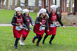 MPs and members of the House of Lords compete in the annual Rehab pancake race, a relay of eleven laps in Victoria Tower Gardens adjacent to the Houses of Parliament in London. The race is held every year on Shrove Tuesday and was won by the Media team. PICTURED: The women of the Media Team.  London, February 13 2018.