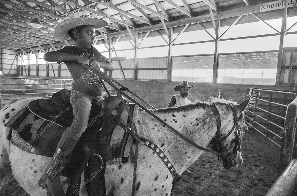 FLEMINGTON, NEW JERSY: Jake holds onto the reins  during a cowboy celebration in Flemington, NJ on Saturday, August 28, 2021.  The celebration featured team sorting, horseback riding and a cookout.    (Brian Branch-Price/TheFotoDesk)