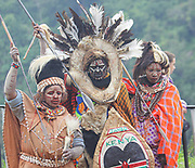 Kikuyu warriors wearing headdress made of bird's feathers. Photographed at Thomson's Falls Kenya