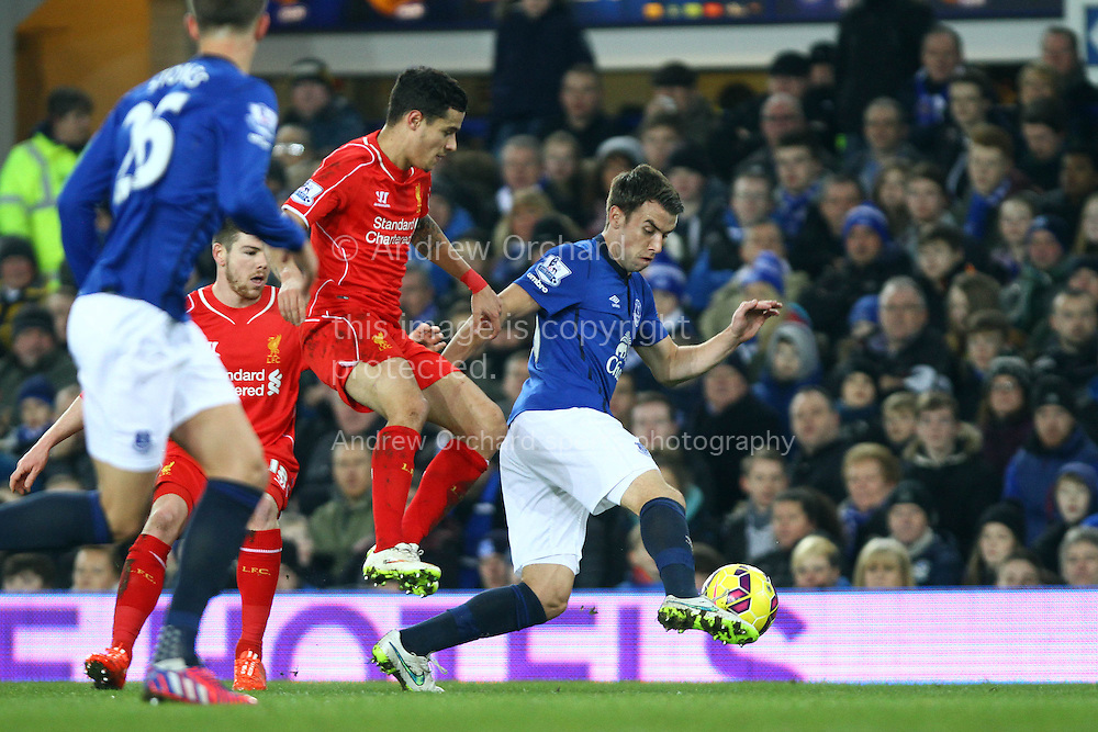 Seamus Coleman of Everton gets away from Philippe Coutinho of Liverpool. Barclays Premier league match, Everton v Liverpool at Goodison Park in Liverpool, Merseyside on Saturday 7th February 2015<br /> pic by Chris Stading, Andrew Orchard sports photography.