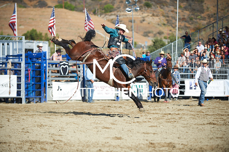 Saddle bronc rider Cort Scheer of Elsmere, NE rides 822 Shady Lady at the Rancho Mission Viejo Rodeo in San Juan Capistrano, CA.<br /> <br /> <br /> UNEDITED LOW-RES PREVIEW<br /> <br /> <br /> File shown may be an unedited low resolution version used as a proof only. All prints are 100% guaranteed for quality. Sizes 8x10+ come with a version for personal social media. I am currently not selling downloads for commercial/brand use.