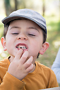 boy showing his lost milk teeth