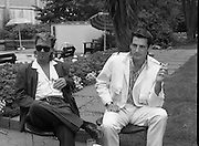 """Sade and Tony Hadley Interviews.  P92..1984.21.08.1984..08.21.1984..21st August 1984..As part of his interview sessions for """"Video File"""" for R.T.E., Marty Whelan interviewed international music stars. The interviews were held in the R.T.E.,studios and at various hotels throughout the city...Gary Kemp and Tony Hadley are pictured in the gardens of Jury's Hotel in Ballsbridge for their interview with Marty Whelan."""