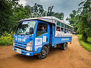 26 OCTOBER 2016 - NUPO TEMPORARY SHELTER, MAE CHAN, TAK, THAILAND:  Buses of Burmese refugees leave the the Nupo Temporary Shelter refugee camp on their way to the Thai / Myanmar border in Mae Sot during their repatriation. Sixtyfive Burmese refugees living in the Nupo Temporary Shelter refugee camp in Tak Province of Thailand were voluntarily repatriated to Myanmar. About 11,000 people live in the camp. The repatriation was the first large scale repatriation of Myanmar refugees living in Thailand. Government officials on both sides of the Thai / Myanmar border said the repatriation was made possible by recent democratic reforms in Myanmar. There are approximately 150,000 Burmese refugees living in camps along the Thai / Myanmar border. The Thai government has expressed interest several times in the last two years in starting the process of repatriating the refugees.    PHOTO BY JACK KURTZ