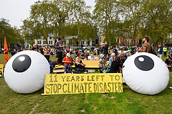 "© Licensed to London News Pictures. 23/04/2019. LONDON, UK.  A big sign and big eyes made by activists gathered at Parliament Square during ""London: International Rebellion"", on day nine of a protest organised by Extinction Rebellion.  Protesters are demanding that governments take action against climate change.  Police have issued a section 14 order for Parliament Square and expect that the occupation of the square will have concluded by the end of the day.  Photo credit: Stephen Chung/LNP"