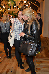 Left to right, HATTIE RICKARDS and AURORE OGDEN at a party to celebrate the publication of 'Inspire: The Art of Living With Nature' by Willow Crossley held at Anthropologie, 131-141 Kings Road, London on 13th March 2014.