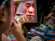 16 JANUARY 2015 - BANGKOK, THAILAND: Performers with Sai Yong Hong Opera Troupe put on their make up before performing at the Chaomae Thapthim Shrine, a Chinese shrine in a working class neighborhood of Bangkok near the Chulalongkorn University campus. The troupe's nine night performance at the shrine is an annual tradition and is the start of the Lunar New Year celebrations in the neighborhood. Lunar New Year, also called Chinese New Year, is officially February 19 this year. Teochew opera is a form of Chinese opera that is popular in Thailand and Malaysia.    PHOTO BY JACK KURTZ