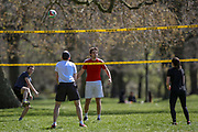 People are seen enjoying the sunny weekend as they play volleyball with their friends and loved ones in Hyde Park, Central London on Saturday, April 17, 2021. England welcomed the return of outdoor drinking and dining on Monday, but the easing of lockdown was also met with concerns about a lack of social distancing, and a wider sense of nervousness within the hospitality sector as businesses tried to operate at a significantly lower capacity and with some confusion over the rules. Millions of people in England will get their first chance in months for haircuts, casual shopping and restaurant meals this week, as the government takes the next step on its lockdown-lifting road map. (Photo/ Vudi Xhymshiti)
