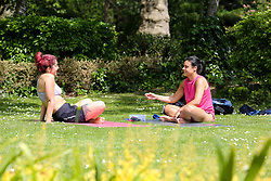 © Licensed to London News Pictures. 18/05/2020. London, UK. Women relax in Finsbury Park, north London as the government relaxes the rules on the COVID-19 lockdown, allowing people to spend more time outdoors whilst following social distancing guidelines. According to the Met Office, warmer weather is forecast this week. Photo credit: Dinendra Haria/LNP