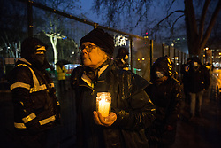 Dorothea Hackman of Camden Civic Society joins environmental activists from HS2 Rebellion at a candlelit vigil for the trees lost, or about to felled, for the HS2 high-speed rail project in Euston Square Gardens on 6 February 2021 in London, United Kingdom. The vigil took place alongside the site of a tunnel in Euston Square Gardens from which bailiffs contracted to HS2 Ltd have been trying to evict nine activists seeking to protect the trees for the past eleven days and also marked the first anniversary of the death of environmental activist Iggy Fox.