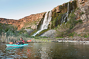 Father and son kayaking bellow thousand springs at Ritter Island in the Snake River Hagerman, Idaho. MR