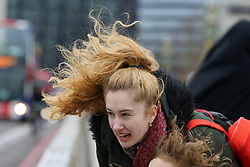 © Licensed to London News Pictures. 01/01/2020. London, UK. Windy weather in the capital as a woman stops to see the London Eve from Westminster Bridge. Photo credit: Dinendra Haria/LNP