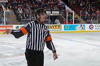 KELOWNA, BC - DECEMBER 30: Referee Mike Langin makes a call on the ice at the Kelowna Rockets against the Prince George Cougars  at Prospera Place on December 30, 2019 in Kelowna, Canada. (Photo by Marissa Baecker/Shoot the Breeze)