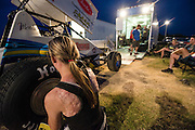 Harli White changing a tire on her sprint car