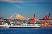 Washington state ferry in Elliott Bay with the Mount Rainier in the distance