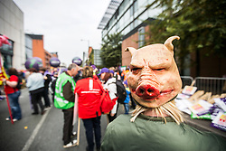 © Licensed to London News Pictures. 04/10/2015. Manchester, UK. Protesters have started to gather in Manchester city centre ahead of a Anti Austerity protest expected to attract thousands of people to protest against Austerity cuts at the start of the Conservative Party Conference in the city. Photo credit: Andrew McCaren/LNP