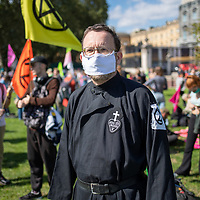 Part of the Christian Climate Action group, Passionist priest Fr. Martin Newell, wears a mask during post-lockdown climate change demonstration in London.