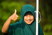 11 JULY 2013 - PATTANI, PATTANI, THAILAND:   A Thai Girl Scout going into Bantaladnadklongkud School in Pattani. There are 108 students at Bantaladnadklongkud School and they are all Muslims. Five of the school's eight teachers are Buddhists.    PHOTO BY JACK KURTZ
