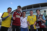 a Group of Burnley fans pose outside Emirates Stadium before k/o. The Emirates FA cup, 4th round match, Arsenal v Burnley at the Emirates Stadium in London on Saturday 30th January 2016.<br /> pic by John Patrick Fletcher, Andrew Orchard sports photography.