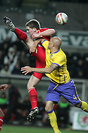 Sam Vokes of Wales is challenged by Daniel Majstorovic of Sweden. International friendly, Wales v Sweden at the Liberty Stadium in Swansea on Wed 3rd March 2010. pic  by  Andrew Orchard