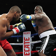 Brandon Lynch (L) fights Vincent Hadley during a One For All Promotions boxing event at the Caribe Royale Orlando Events Center on Saturday, February 20, 2021 in Orlando, Florida. (Alex Menendez via AP)