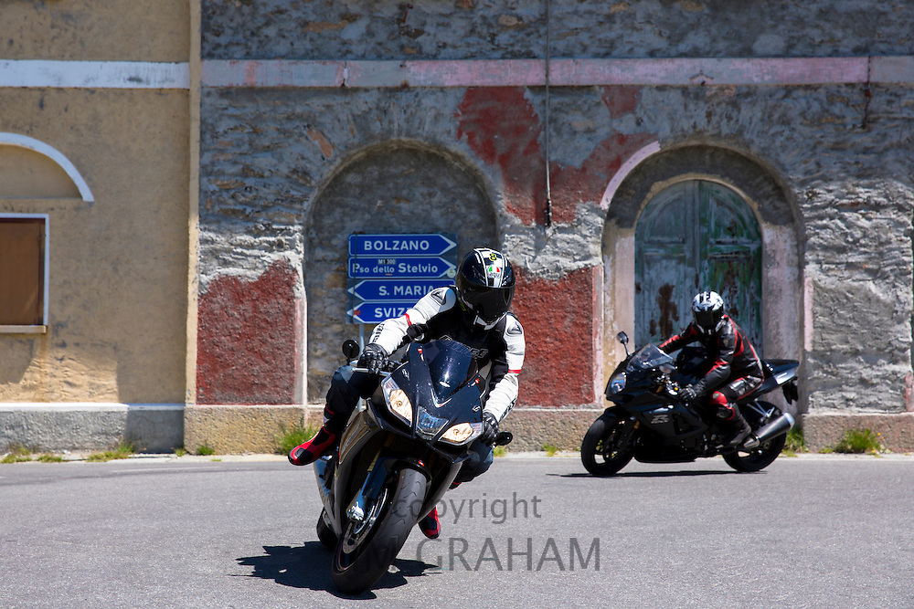 Motorcyclists drive The Stelvio Pass, Passo dello Stelvio, Stilfser Joch, to Bormio, Northern Italy
