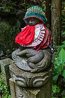 Jizo at Taisanji - Temple No. 52 of the Shikoku 88 temple pilgrimage. The main hall which was rebuilt in 1305,has been designated as a National Treasure, while the Niomon Gate is an important national cultural property.  Taisanji has wonderful views of the Shikoku Mountains.  The main bhall is one of the more spectacular on the pilgrimage and said to have been built in one day by a merchant who was miraculously delivered from a storm while sailing with a cargo on the Inland Sea.  An unforgettable feature of Taisan-ji is the bell tower with its paintings of heaven and shocking picture of hell.