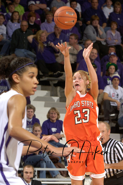 Idaho State guard Andrea Lightfoot (23) hits a three pointer over Kansas State's Marlies Gipson (L), during the first half at Bramlage Coliseum in Manhattan, Kansas, March 17, 2006.  K-State defeated the Bengals 88-68 in the first round of the WNIT.