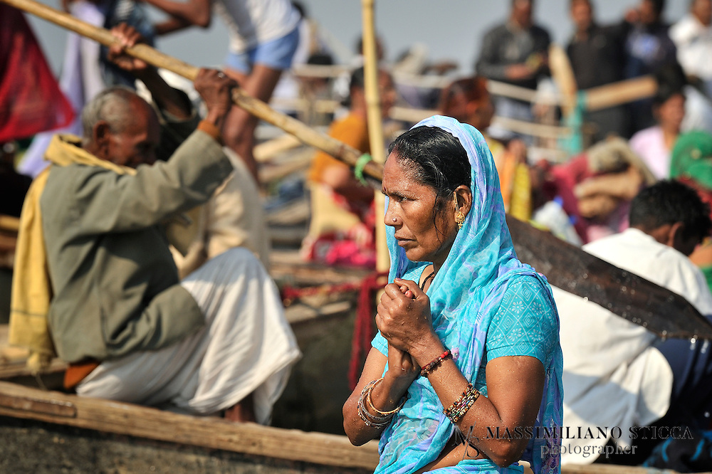 Hindu devotee prays after a holy dip at the sandbar in the middle of Sangam on the Mauni Amawasya day.