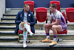 A dejected Finn Russell of Racing 92 sits with Stuart Hogg of Exeter Chiefs after the final whistle of the match   - Mandatory by-line: Rogan/JMP - 17/10/2020 - RUGBY - Ashton Gate Stadium - Bristol, England - Exeter Chiefs v Racing 92 - Heineken Champions Cup Final