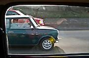 scene along a cross country trip with in a classic Mini Cooper auto - classic Mini Cooper passes a classic Mini Cooper
